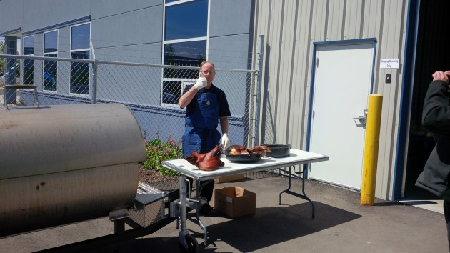 Trison Tarps founder Paul Vandenberg gives the thumbs up after carving into the roasted pig.