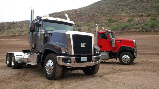 A pair of Cat CT680s in the Arizona desert at Cat's TInaja Hills proving grounds.