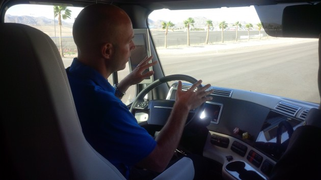 A driver demonstrates hands-free driving using Highway Pilot.