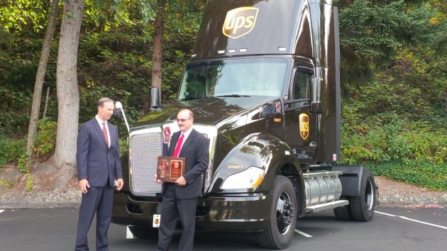 Robert Filosa of UPS (right) received a plaque from Kenworth GM Preson Feight.