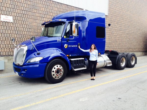 Assistant editor Soia Straface steps into a 2015 International ProStar with the help of a driver trainer to drive a truck for the first time.