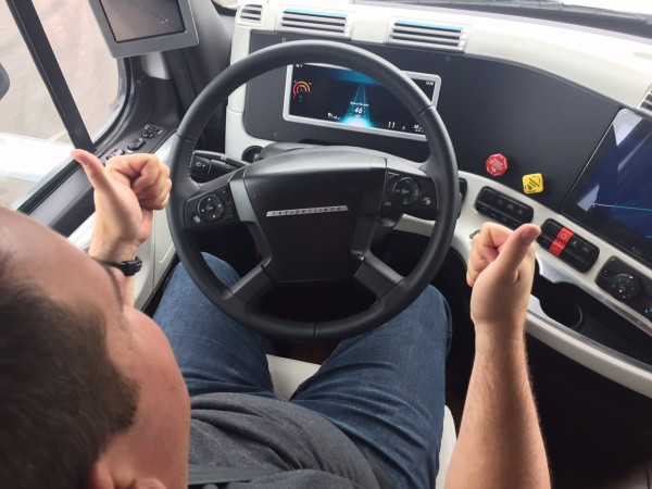 James Menzies removes his hands from the wheel while in Highway Pilot mode.