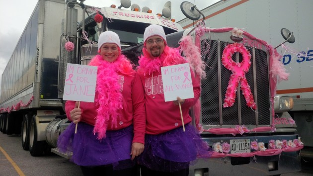 Ken Layton (right) and wife Melissa Layton deck out their truck (and themselves) for the convoy.