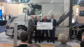 Searcy Trucking president Norm Blagden (second from right) accepts a cheque from Volvo Trucks and Michelin.