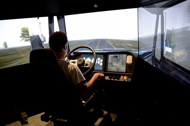 A Celadon Driving Academy student practices his driving skill on the TransSim(TM) VS6 driving simulator. This machine provides real world driving environments specifically designed for training commercial vehicle truck drivers. (PRNewsFoto/Celadon Trucking)