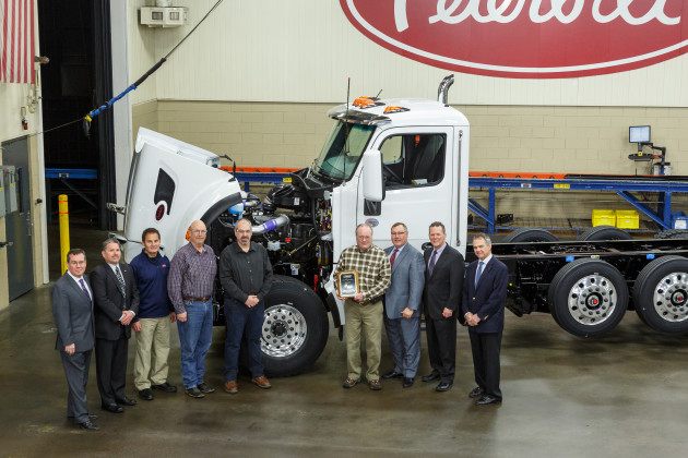 A recent customer event with Peterbilt presenting a Model 567 set-forward front axle truck equipped with the first production PACCAR MX-11 engine to Knife River CorporationFrom left to right: Charles Cook, Marketing Manager Vocational Products; Rick Paul, District Sales Manager; Ron Augustyn, Peterbilt Denton Plant Manager; Randy Kephart, Knife River Equipment Manager; Scott Hammond, Knife River Northwest Region Equipment Manager; Colin Milligan, Knife River Shop Manager; Robert Woodall, Peterbilt Assistant General Manager of Sales and Marketing; Leon Handt, Peterbilt Assistant General Manager of Operations; and Jim Zito, Director of Sales Vocational Products.