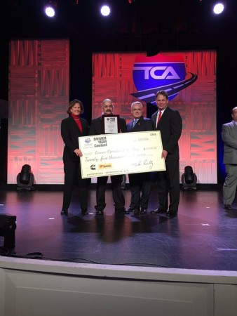 Mark Tricco (centre) of Bison Transport was named TCA's 2015 O/O of the Year