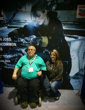 Lisa Kelly from the show Ice Road Truckers takes a picture with a fan at Truck World in Toronto April 15.