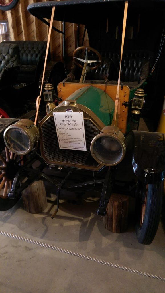"A 1909 International High Wheelers Model A Autobuggy can be found in 3 Valley Gap, B.C. with a sign that reads, ""beginning of International Trucks."""