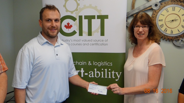 Mike Upwood, treasurer of the Toronto Area Council presenting the cheque for $5000 to Lorna Catrambone the Regional Development Coordinator, Central Canada for the Charity Threads of Life