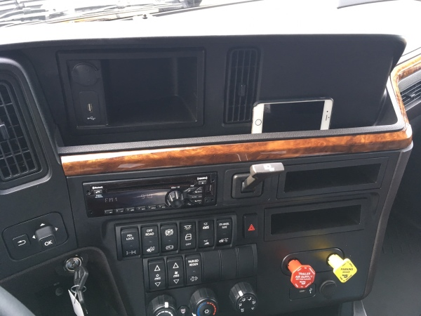 A groove along the dash is useful for storing small items and the air brake releases were relocated to the right.