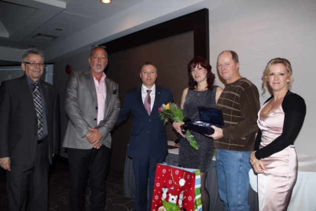 Left to right: Peter Bonneville, director of safety, Tom Payne, president, Thomas McKee, vice-president of driver services and innovation, Tanya and John Unrau (driver of the year and his wife) and Andrea McNicholl, safety administrator.