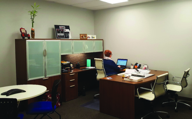 STA executive director Susan Ewart works in her new office.