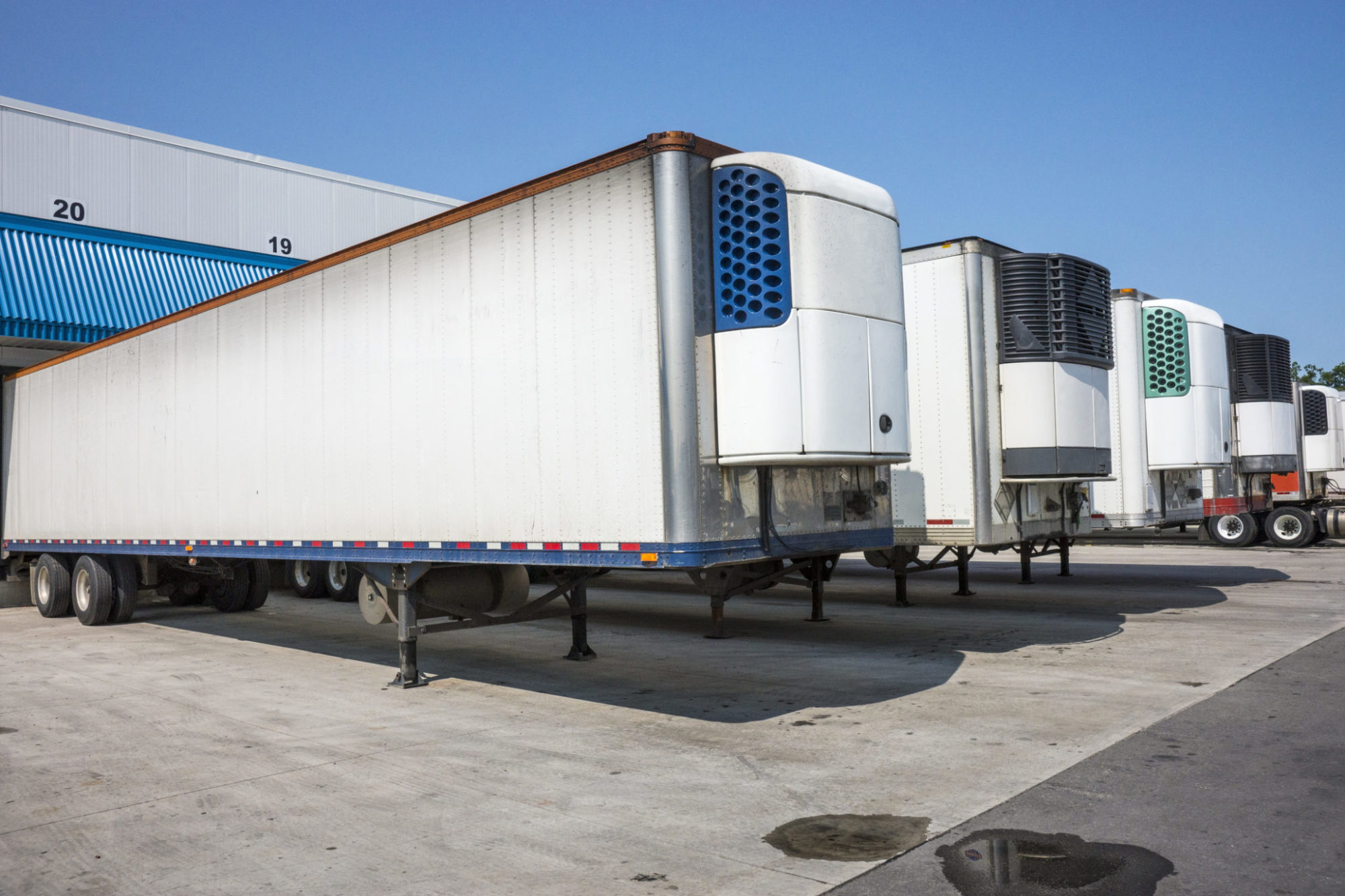 Refrigerated truck trailers at a distribution warehouse - Truck News