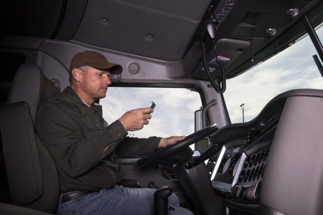 truck driver with cell phone
