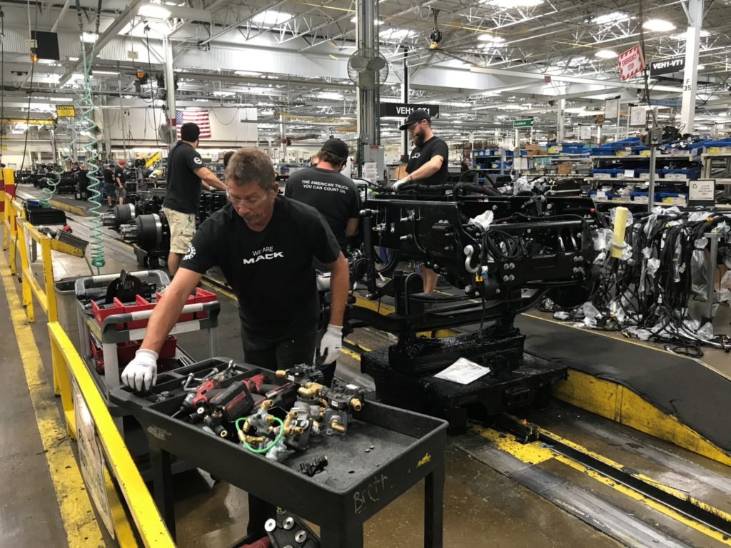 Showing a worker at a Mack Trucks plant