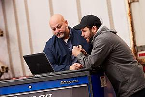 mechanics reviewing shop software
