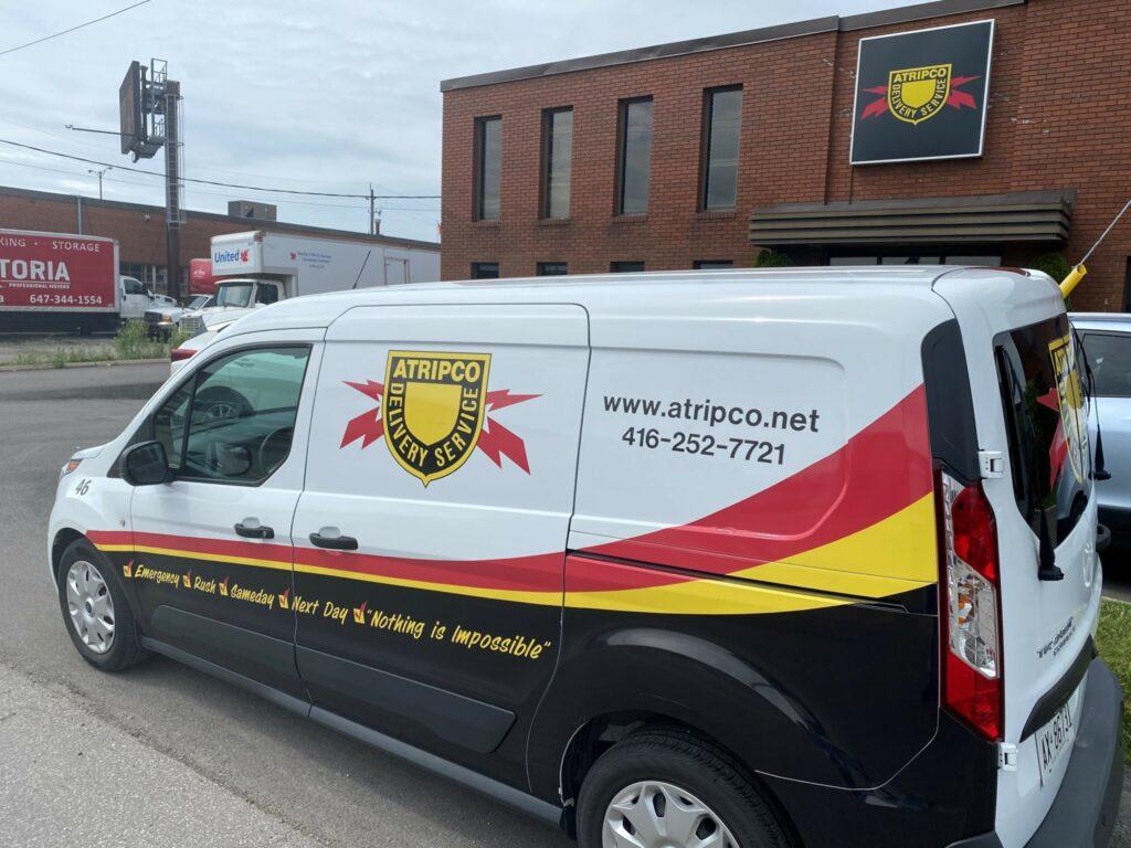 Atripco van in front of building