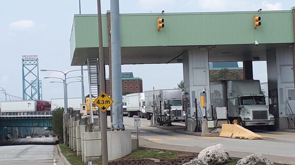 Showing trucks lined up at Ambassador Bridge