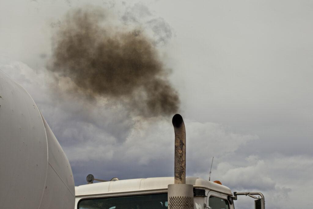 A truck belching smoke.