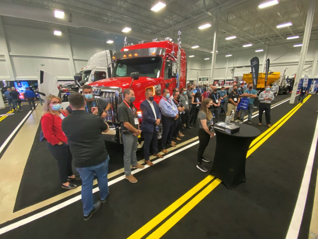 Showing a crowd at ExpoCam gaathered around the Western Star booth
