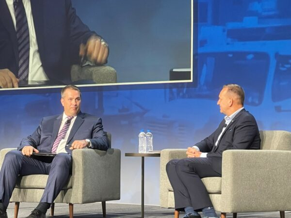 Erik Neandross of Gladstein, Neandross and Associates, talks electric vehicles with Volvo's Peter Voorhoeve