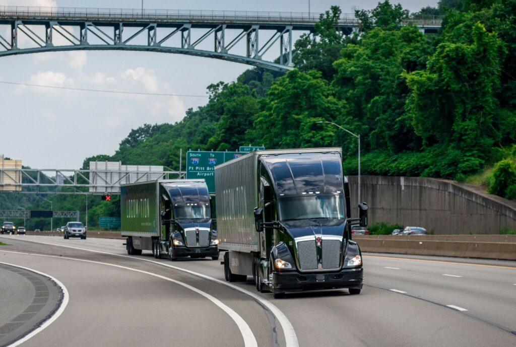 Showing Locomation-powered Kenworth trucks on highway